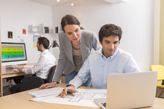 Business team working on laptop in office Royalty Free Stock Photo