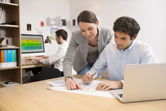 Business team working on laptop in office Stock Photography