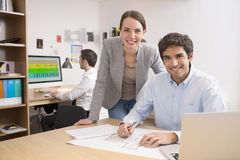 Business team working on laptop in office Stock Images