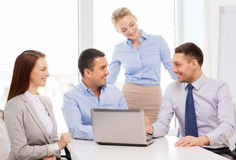 Business team working with laptop in office Stock Images