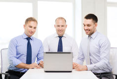 Business team working with laptop in office Stock Photo