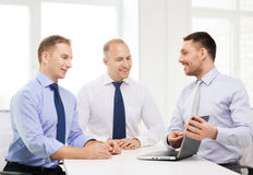 Business team working with laptop in office Stock Image