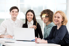 Business team working with laptop in office Stock Photos