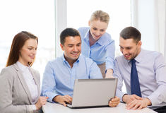Business team working with laptop in office Royalty Free Stock Images