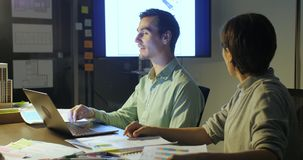 Business team working late through the night. Casual young people in architecture company. stock footage