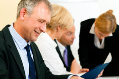 Business team working in a meeting Stock Image