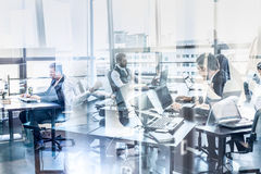 Business team working in modern corporate office. Royalty Free Stock Image