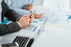 Business team working at office desk Stock Image