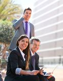 Business team working outdoors. Royalty Free Stock Photos