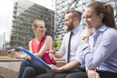 Business team working outdoors Royalty Free Stock Image