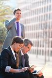 Business team working outdoors with tablet. Stock Photo