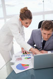 Business team working on survey results Stock Photography