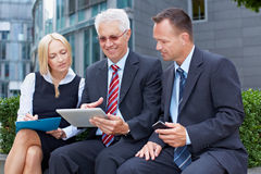 Business team working on tablet Royalty Free Stock Image