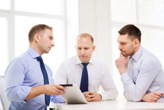 Business team working with tablet pc in office Royalty Free Stock Images