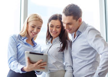 Business team working with tablet pc in office Stock Photo