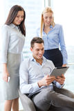 Business team working with tablet pc in office Stock Images