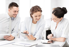 Business team working with tablet pcs in office Stock Photography