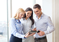 Business team working with tablet pcs in office Stock Photos