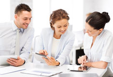 Business team working with tablet pcs in office Royalty Free Stock Image