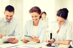 Business team working with tablet pcs in office Royalty Free Stock Photography