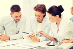 Business team working with tablet pcs in office Stock Image