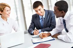 Business team working on their business project together. At office Stock Photos