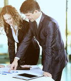 Business team working on their business project together the office Royalty Free Stock Photos