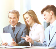 Business team working on their business project together in office Stock Photography