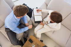 Business team working together on the couch scheduling in diary Royalty Free Stock Photo