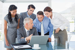 Business team working together on laptop Royalty Free Stock Photography