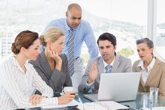 Business team working together on laptop Stock Images