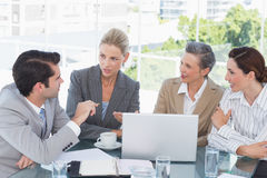 Business team working together on laptop Royalty Free Stock Image