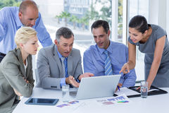 Business team working together on laptop Stock Image