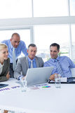 Business team working together on laptop Royalty Free Stock Images