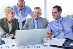 Business team working together on laptop Royalty Free Stock Photo