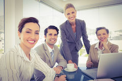 Business team working together on laptop Stock Photo