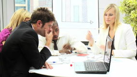 Business team working together with a laptop in office stock footage