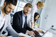 Business team working together to achieve better results Stock Photos