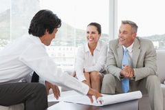 Business team working together with plans Stock Photos