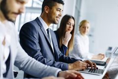Business team working together to achieve better results Stock Photo