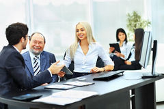 The business team works with the financial documents Stock Images