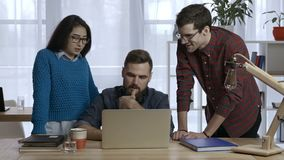 Business team works on project together at office stock footage