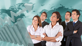 Business team with a world map Stock Photography