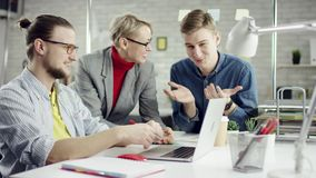 Business team of young people enjoying working together, millennials group talking having fun in cozy office, good stock footage