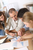 Business team of young people working on budget royalty free stock photography