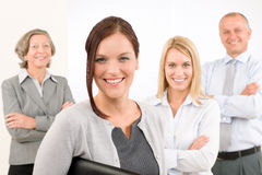 Business team young woman with mature colleagues Royalty Free Stock Photos