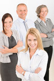 Business team young woman with mature colleagues Stock Photos