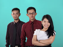 Business teams profile, on turquoise background. Business teams of three Asian corporate workers posing over turquoise colored studio background Stock Photography