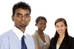 Business Teamwork. A young diverse business team of three different race individuals Royalty Free Stock Photo