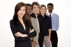 Business Teamwork. A group of attractive young adults in business wear Stock Image